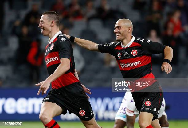 Mitchell Duke of the Wanderers celebrates after scoring his teams second goal during the A-League match between the Western Sydney Wanderers and the...