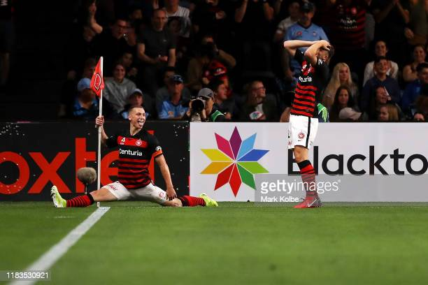 Mitchell Duke of the Wanderers celebrates scoring a goal during the round three A-League match between the Western Sydney Wanderers and Sydney FC at...