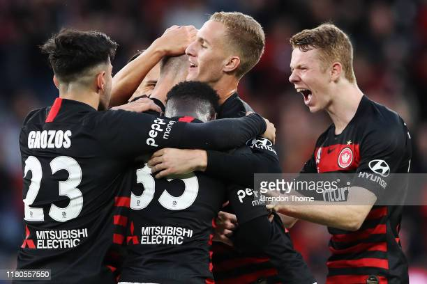 Mitchell Duke of the Wanderers celebrates scoring a goal with team mates during the round one A-League match between the Western Sydney Wanderers and...