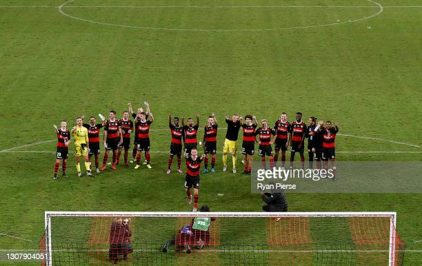 Mitchell Duke of the Wanderers celebrates victory with team mates after the A-League match between the Western Sydney Wanderers and the Perth Glory...