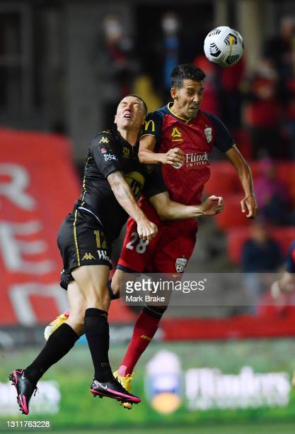 Mitchell Duke of the Wanderers competes with Juan De Dios Prados Lopez of Adelaide United during the A-League match between Adelaide United and the...