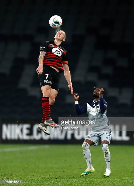 Mitchell Duke of the Wanderers heads the ball during the round 24 A-League match between the Western Sydney Wanderers and the Melbourne Victory at...
