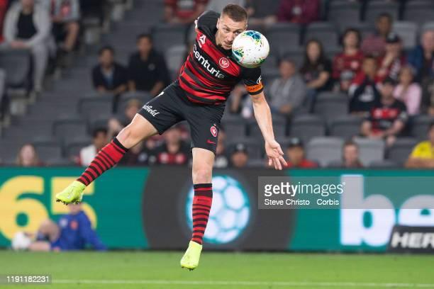 Mitchell Duke of the Wanderers heads the ball during the round 7 A-League match between the Western Sydney Wanderers and Melbourne City at Bankwest...
