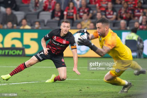 Mitchell Duke of the Wanderers heads the ball towards goal and is saved by City's Dean Bouzanis during the round 7 A-League match between the Western...