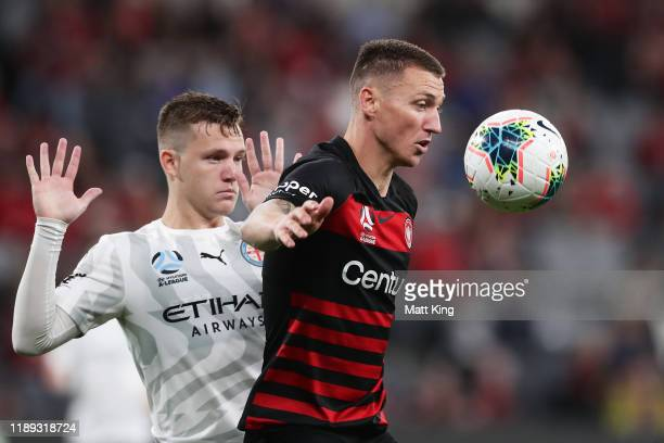 Mitchell Duke of the Wanderers is challenged by Scott Galloway of Melbourne City FC during the round 7 A-League match between the Western Sydney...