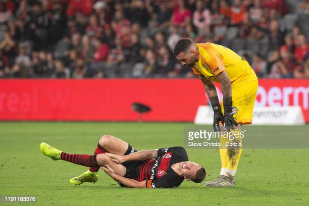Mitchell Duke of the Wanderers is injured a tackle with City's Rostyn Griffiths is assisted by Dean Bouzanis during the round 7 A-League match...