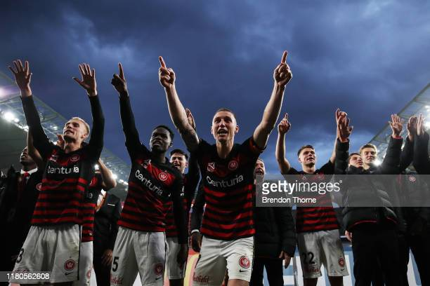 Mitchell Duke of the Wanderers leads his team mates in celebrations with Wanderers fans during the round one ALeague match between the Western Sydney...