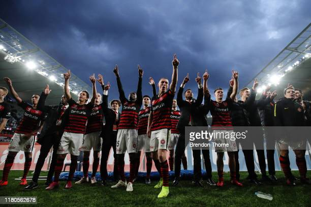 Mitchell Duke of the Wanderers leads his team mates in celebrations with Wanderers fans during the round one A-League match between the Western...