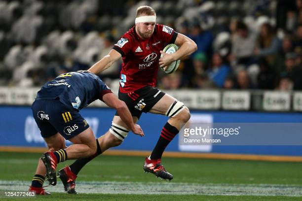 Mitchell Dunshea of the Crusaders is tackled by Ngatungane Punivai of the Highlanders of the Highlanders during the round 4 Super Rugby Aotearoa...