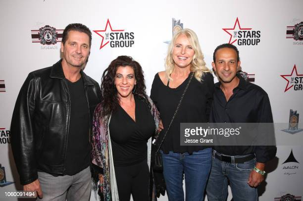 Mitchell Englander and guests attend Heroes For Heroes Los Angeles Police Memorial Foundation Celebrity Poker Tournament at Avalon Hollywood on...