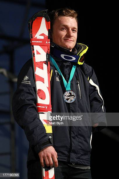 Mitchell Gourley of Australia poses on the podium after his third place in the Mens Slalom Standing LW6/82 race during the IPC Alpine Adaptive Slalom...