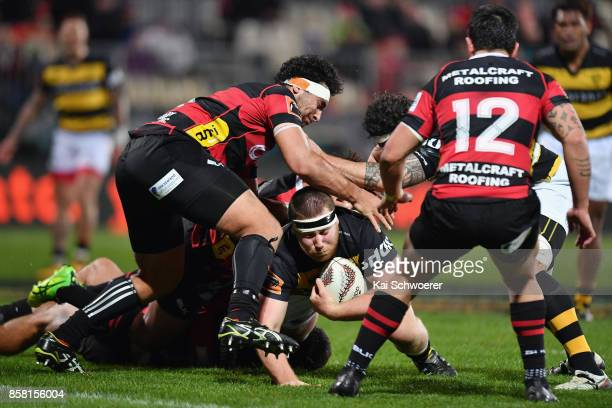 Mitchell Graham of Taranaki is tackled during the round eight Mitre 10 Cup match between Canterbury and Taranaki at AMI Stadium on October 6 2017 in...