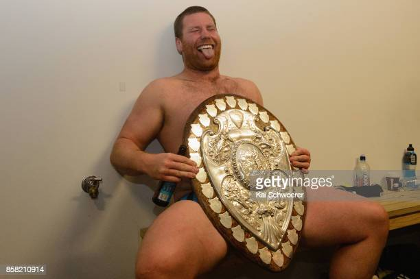 Mitchell Graham of Taranaki poses with the Ranfurly Shield after the win in the round eight Mitre 10 Cup match between Canterbury and Taranaki at AMI...