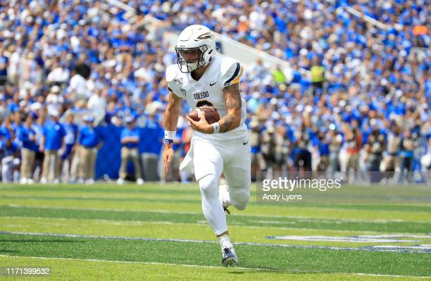 Mitchell Guadagni of the Toledo Rockets runs for a touchdown against the Kentucky Wildcats at Commonwealth Stadium on August 31, 2019 in Lexington,...