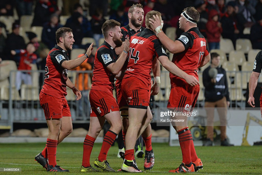 Mitchell Hunt, Mitchell Drummond, Luke Romano, Johnny McNicholl and Wyatt Crockett of the Crusaders (L-R) celebrate after Johnny McNicholl scores a try during the round 16 Super Rugby match between the Crusaders and the Rebels at AMI Stadium on July 9, 2016 in Christchurch, New Zealand.