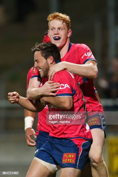 Mitchell Hunt of Tasman celebrates with Finlay Christie after scoring a try during the Mitre 10 Cup Semi Final match between Taranaki and Tasman at...