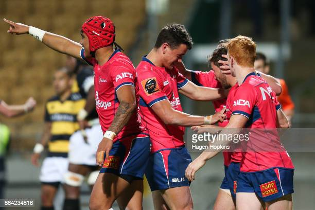 Mitchell Hunt of Tasman celebrates with teammates after scoring a try during the Mitre 10 Cup Semi Final match between Taranaki and Tasman at Yarrow...