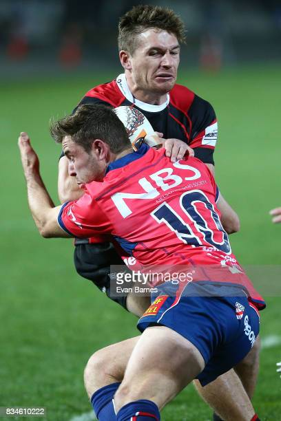 Mitchell Hunt of Tasman tackles George Bridge during the during the Mitre 10 Cup round one match between Tasman and Canterbury at Trafalgar Park on...