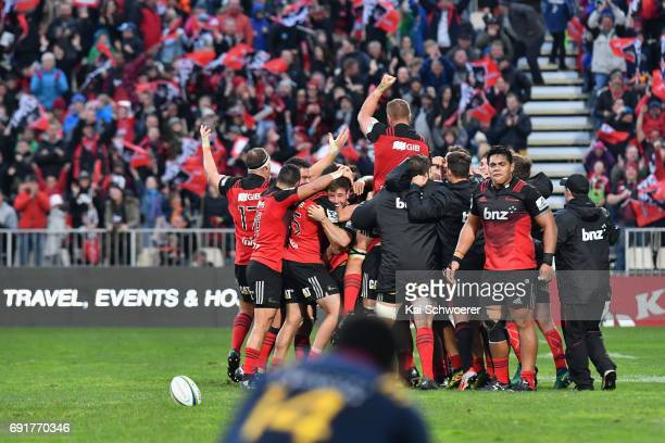 Mitchell Hunt of the Crusaders is congratulated by team mates after kicking a last minute drop goal during the round 15 Super Rugby match between the...