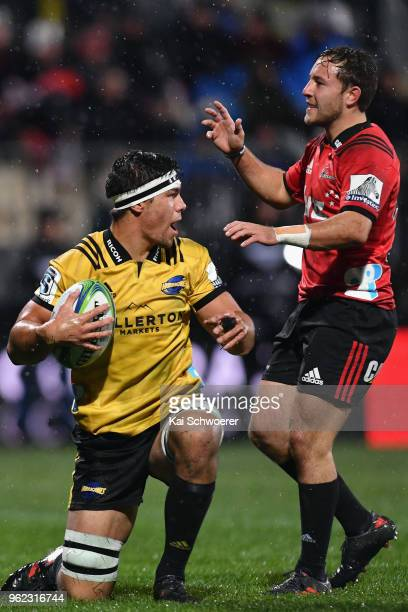 Mitchell Hunt of the Crusaders reacts aas Reed Prinsep of the Hurricanes celebrates scoring a try during the round 15 Super Rugby match between the...