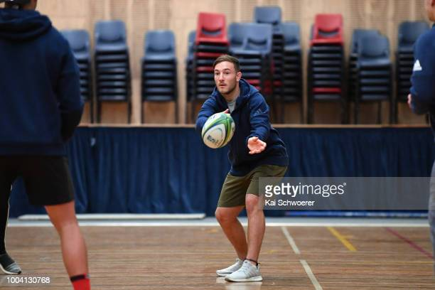 Mitchell Hunt passes the ball during a Crusaders Super Rugby training session at St Andrew's College on July 23 2018 in Christchurch New Zealand