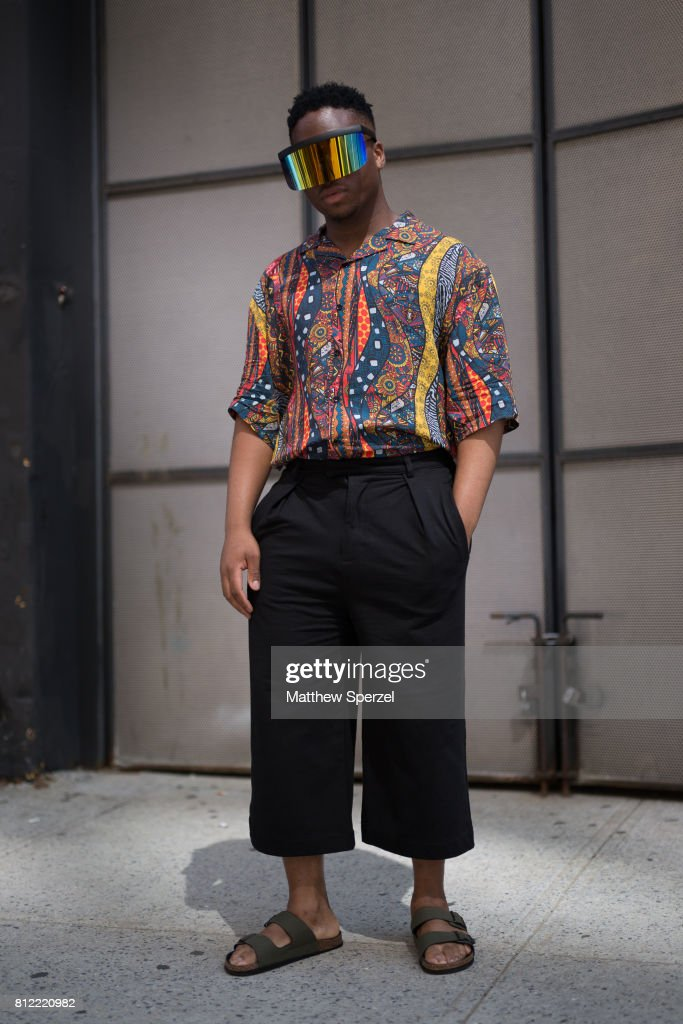 CJ Mitchell is seen attending TEDDY ONDO ELLA during Men's New York Fashion Week wearing a shirt from Zara and Birkenstock sandals on July 10, 2017 in New York City.