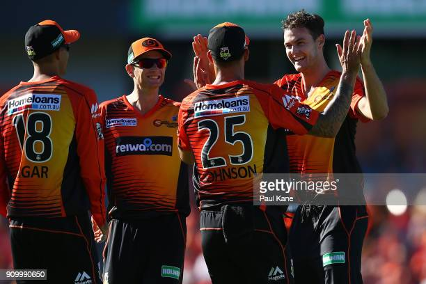 Mitchell Johnson and Matthew Kelly of the Scorchers celebrate the wicket of Jonathon Dean of the Strikers during the Big Bash League match between...