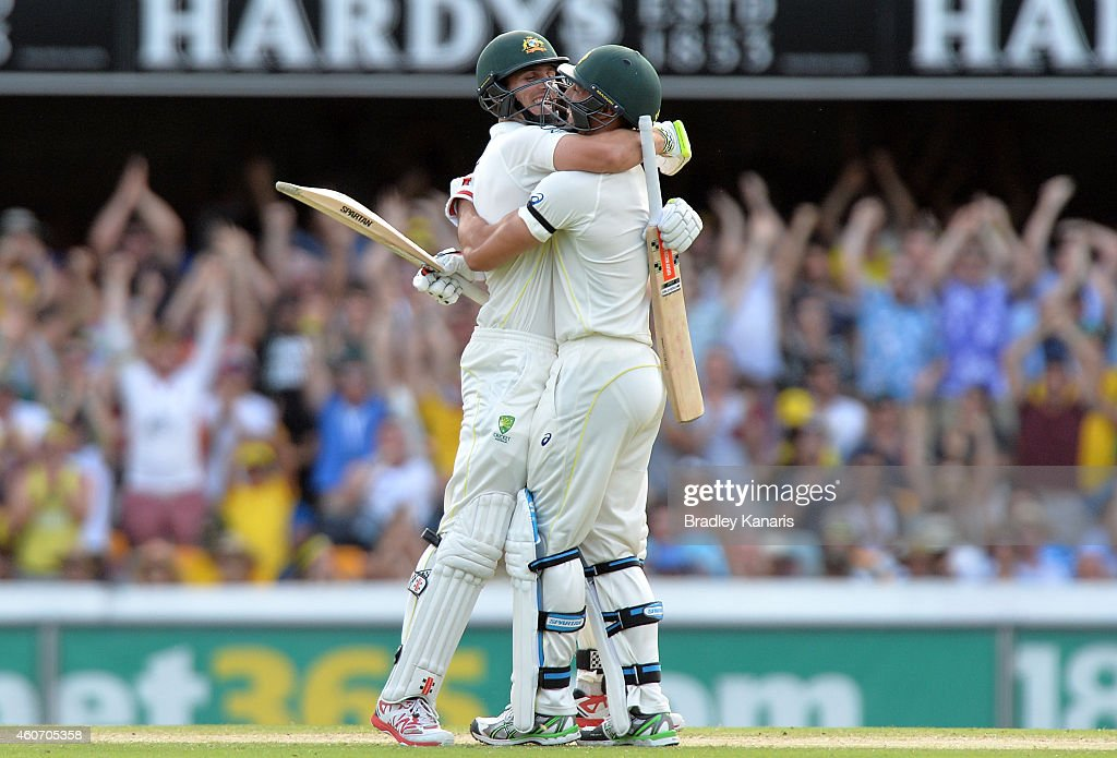 Mitchell Johnson and Mitchell Marsh of Australia celebrate victory during day four of the 2nd Test match between Australia and India at The Gabba on December 20, 2014 in Brisbane, Australia.