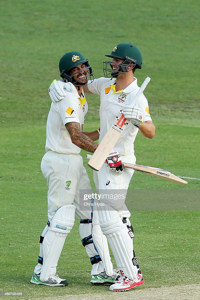 Mitchell Johnson and Mitchell Marsh of Australia celebrate winning on day four of the 2nd Test match between Australia and India at The Gabba on December 20, 2014 in Brisbane, Australia.