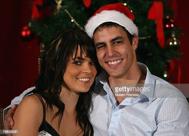 Mitchell Johnson and partner Jess Bratich pose for photos during the Australian cricket team Christmas lunch at Crown Casino on December 25 2007 in...