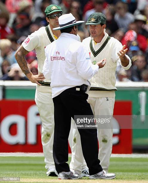 Mitchell Johnson and Ricky Ponting of Australia have a discussion regarding a referred decision with Umpire Aleem Daar during day two of the Fourth...