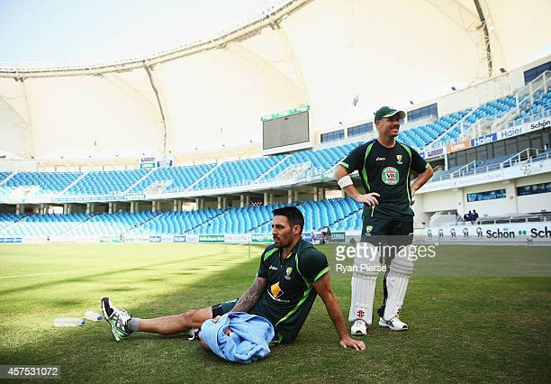 Mitchell Johnson of Australia and David Warner of Australia cool down during an Australian Nets Session at Dubai International Stadium on October 20,...