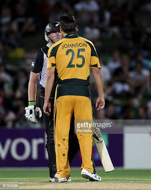 Mitchell Johnson of Australia and Scott Styris of New Zealand touch heads during the First One Day International match between New Zealand and...
