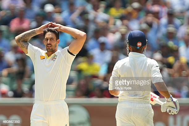 Mitchell Johnson of Australia and Virat Kohli of India exchange words during day three of the Third Test match between Australia and India at...