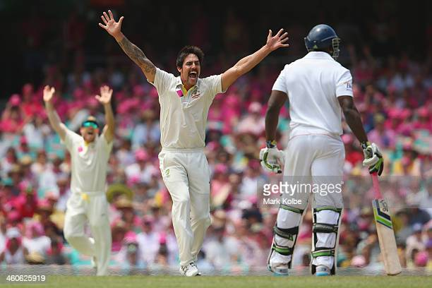 Mitchell Johnson of Australia appeas successfully for the wicket of Alastair Cook of England during day three of the Fifth Ashes Test match between...