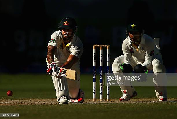 Mitchell Johnson of Australia bats as Sarfraz Ahmed of Pakistan keeps wicket during Day Three of the First Test between Pakistan and Australia at...