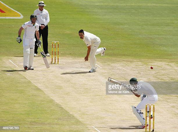Mitchell Johnson of Australia bowls at Robin Peterson of South Africa during day three of the First Test match between South Africa and Australia on...