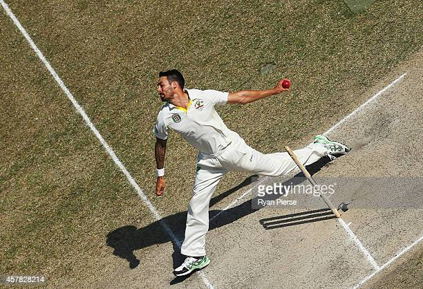 Mitchell Johnson of Australia bowls during Day Four of the First Test between Pakistan and Australia at Dubai International Stadium on October 25...