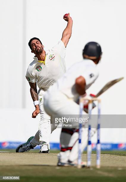 Mitchell Johnson of Australia bowls during Day One of the Second Test at Sheikh Zayed Stadium on October 30 2014 in Abu Dhabi United Arab Emirates