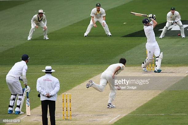 Mitchell Johnson of Australia bowls out Kevin Pietersen of England during day two of the Fourth Ashes Test Match between Australia and England at...