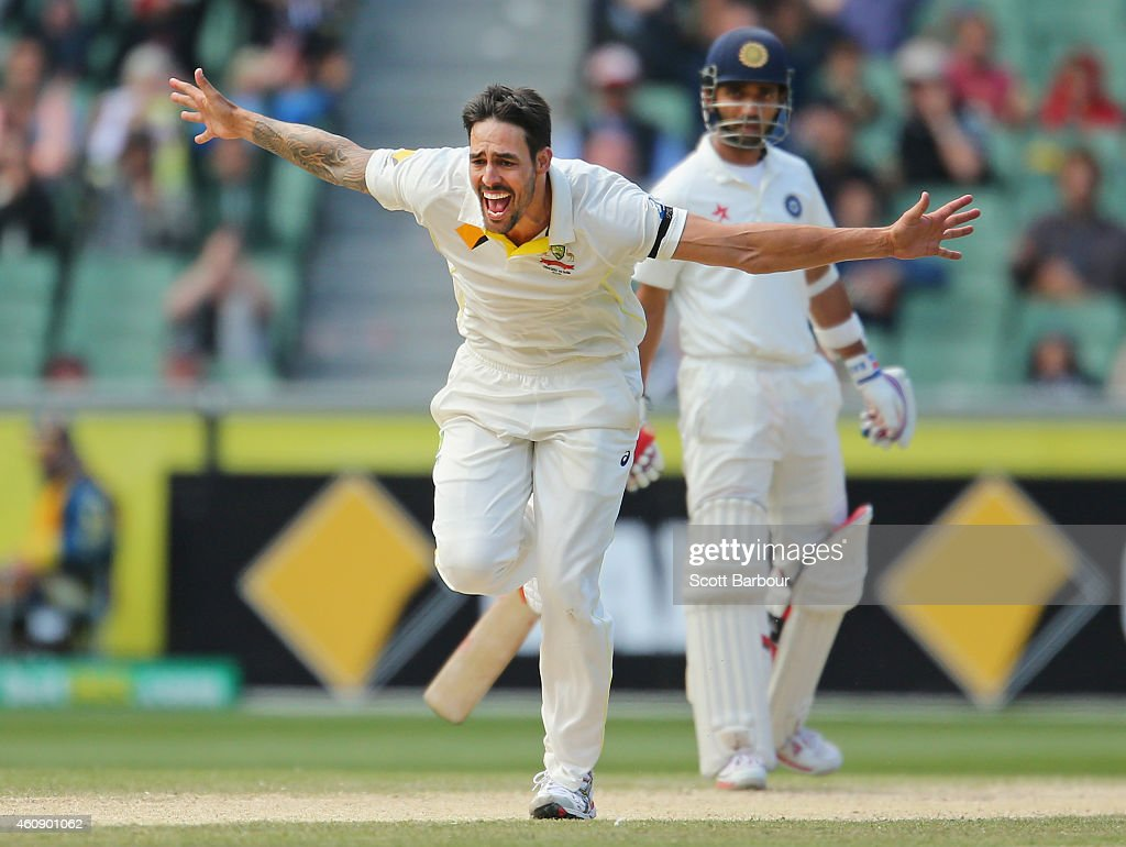 Mitchell Johnson of Australia celebrates after bowling Cheteshwar Pujara of India during day five of the Third Test match between Australia and India at Melbourne Cricket Ground on December 30, 2014 in Melbourne, Australia.