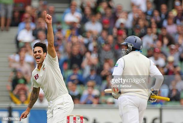 Mitchell Johnson of Australia celebrates after dismissing Tillakaratne Dilshan of Sri Lanka during day three of the Second Test match between...
