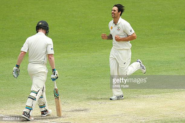 Mitchell Johnson of Australia celebrates after dismissing James Neesham of New Zealand during day five of the First Test match between Australia and...