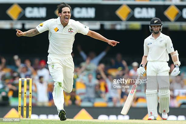 Mitchell Johnson of Australia celebrates after dismissing Ross Taylor of New Zealand during day two of the First Test match between Australia and New...