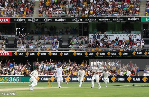 Mitchell Johnson of Australia celebrates after taking the wicket of Graeme Swann of England during day two of the First Ashes Test match between...