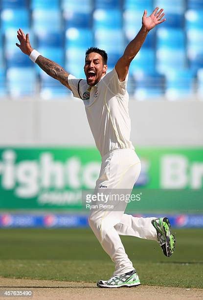 Mitchell Johnson of Australia celebrates after taking the wicket of Mohammad Hafeez of Pakistan during Day One of the First Test between Pakistan and...