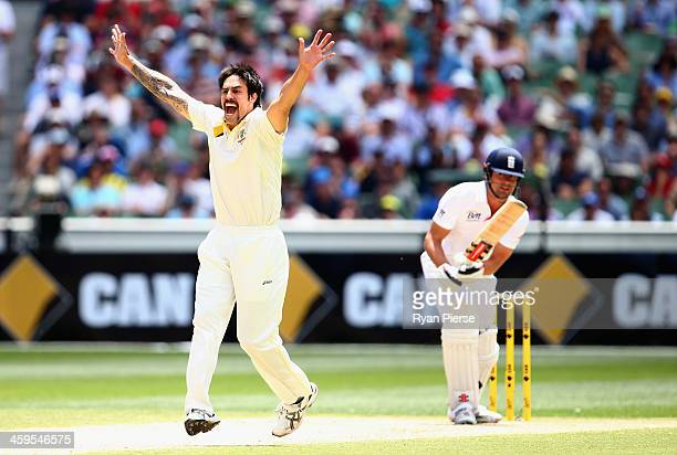 Mitchell Johnson of Australia celebrates after taking the wicket of Alastair Cook of England during day three of the Fourth Ashes Test Match between...