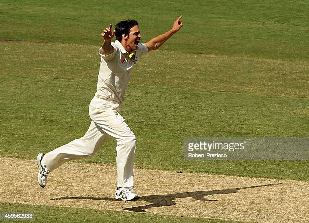 Mitchell Johnson of Australia celebrates after taking the wicket of Jonny Bairstow of England during day three of the Fourth Ashes Test Match between...