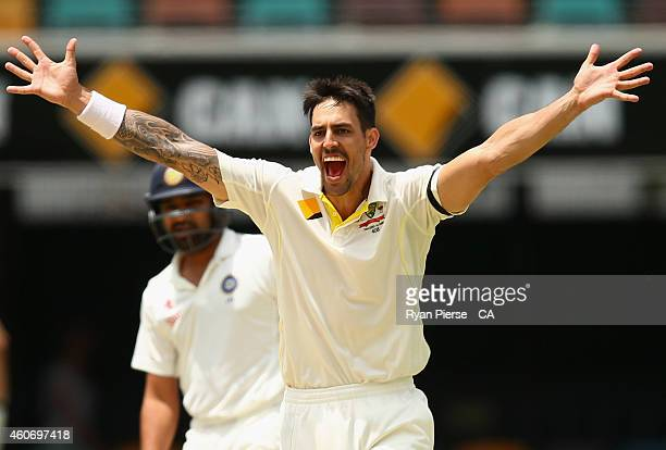 Mitchell Johnson of Australia celebrates after taking the wicket of Rohit Sharma of India during day four of the 2nd Test match between Australia and...