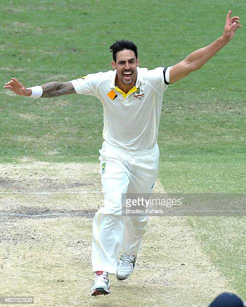 Mitchell Johnson of Australia celebrates after taking the wicket of Umesh Yadav of India during day four of the 2nd Test match between Australia and...